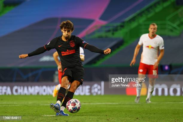 Joao Felix of Atletico de Madrid scores a penalty for his team's first goal during the UEFA Champions League Quarter Final match between RB Leipzig...