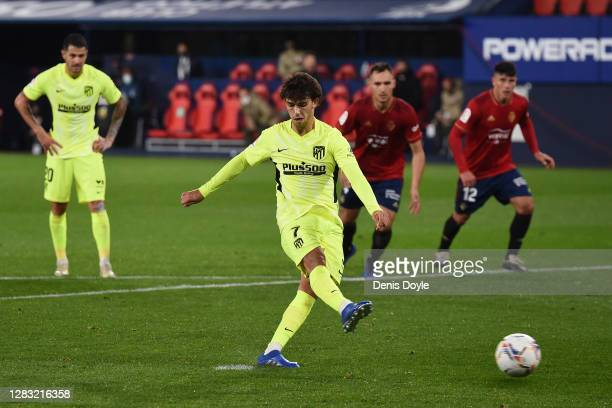 Joao Felix of Atletico de Madrid scores a penalty for his team's first goal during the La Liga Santander match between CA Osasuna and Atletico de...