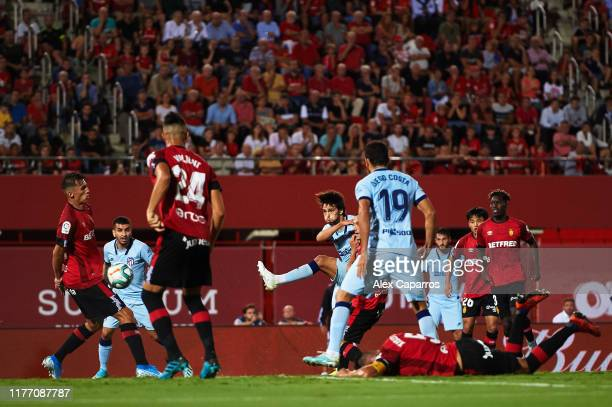 Joao Felix of Atletico de Madrid scores his team's second goal during the La Liga match between RCD Mallorca and Club Atletico de Madrid at Iberostar...