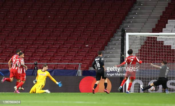 Joao Felix of Atletico de Madrid scores his team's second goal during the UEFA Champions League Group A stage match between Atletico Madrid and RB...