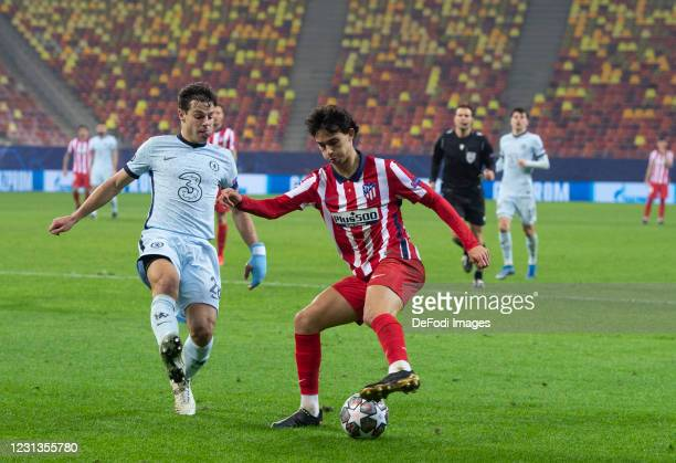 Joao Felix of Atletico Madrid and Cesar Azpilicueta of FC Chelsea battle for the ball during the UEFA Champions League Round of 16 match between...