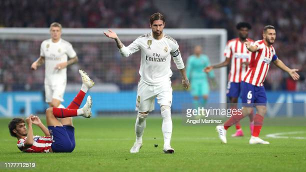 Joao Felix of Atletico Madrid battles for the ball with Sergio Ramos of Real Madrid during the Liga match between Club Atletico de Madrid and Real...