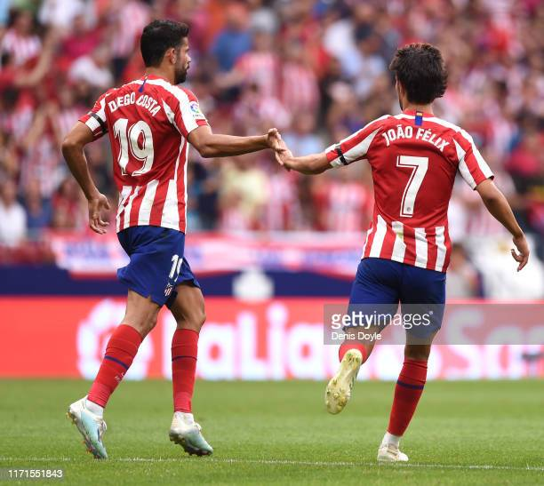 Joao Felix of Atletico Madrid celebrates with teammate Diego Costa after scoring his team's first goal during the Liga match between Club Atletico de...