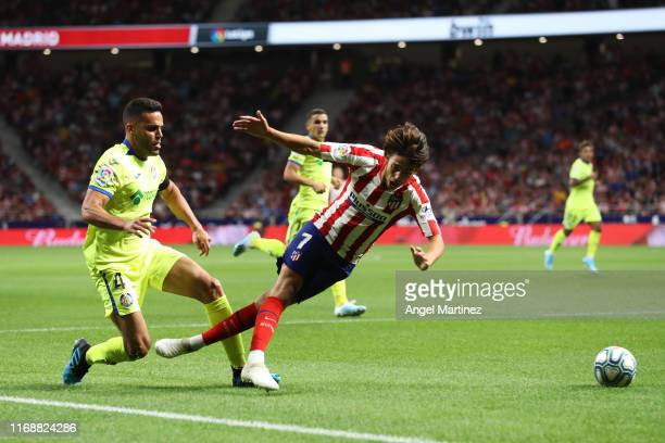 Joao Felix of Atletico Madrid is fouled by Bruno of Getafe for a penalty kick during the Liga match between Club Atletico de Madrid and Getafe CF at...