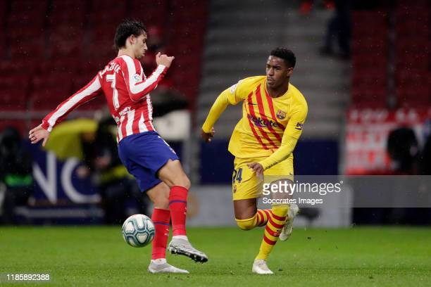 Joao Felix of Atletico Madrid, Junior Firpo of FC Barcelona during the La Liga Santander match between Atletico Madrid v FC Barcelona at the Estadio...