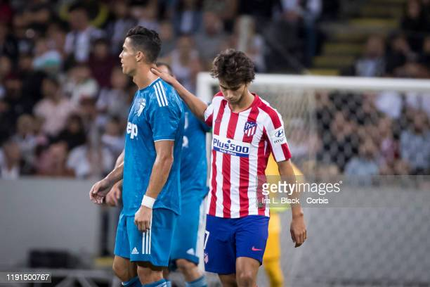 Joao Felix of Atletico Madrid puts his hand on Cristiano Ronaldo of Juventus after scoring a goal during the international Champions Cup Friendly...