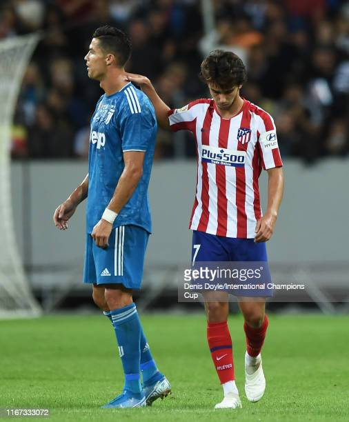 Joao Felix of Atletico Madrid reacts with Cristiano Ronaldo of Juventus after scoring Atletico's opening goal during the International Champions Cup...