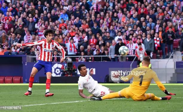 Joao Felix of Atletico Madrid scores his team's second goal during the Liga match between Club Atletico de Madrid and Sevilla FC at Wanda...