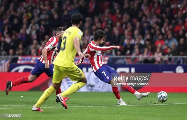 Joao Felix of Atletico Madrid scores his team's third goal during the La Liga match between Club Atletico de Madrid and Villarreal CF at Wanda...