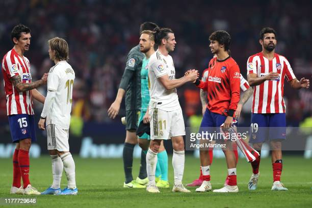 Joao Felix of Atletico Madrid speaks to Gareth Bale of Real Madrid after the Liga match between Club Atletico de Madrid and Real Madrid CF at Wanda...