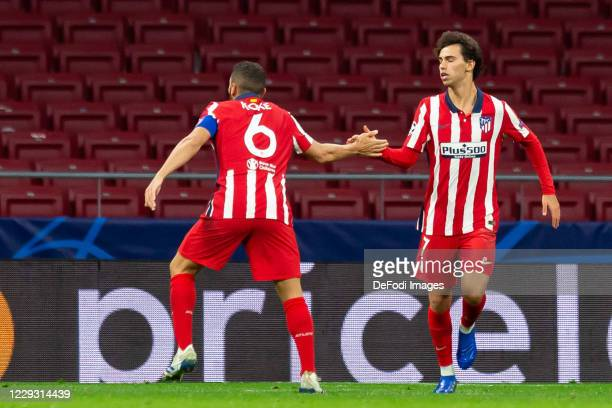 Joao Felix of Atletico Madrid with Koke of Atletico Madrid celebrates after scoring his team's second goal during the UEFA Champions League Group A...