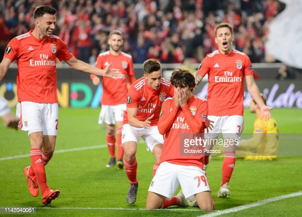 Joao Felix of Benfica celebrates with teammates after scoring his team's fourth goal during the UEFA Europa League Quarter Final First Leg match...