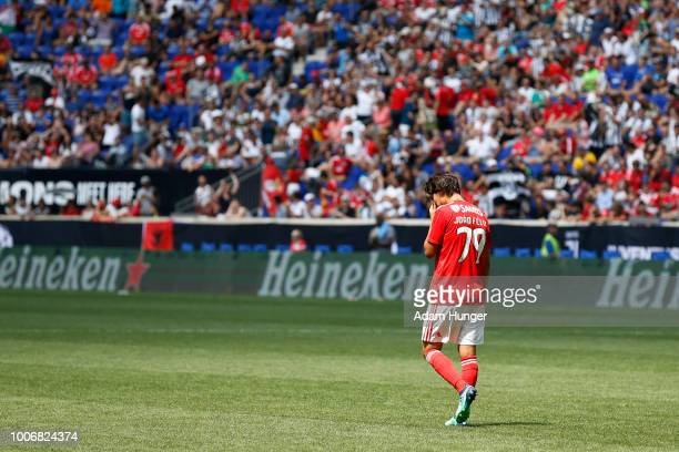 Joao Felix of Benfica reacts after missing a shot during penalty kicks against Juventus during the International Champions Cup 2018 match between...