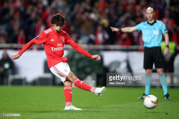 Joao Felix of Benfica scores his team's first goal from the penalty spot during the UEFA Europa League Quarter Final First Leg match between Benfica...