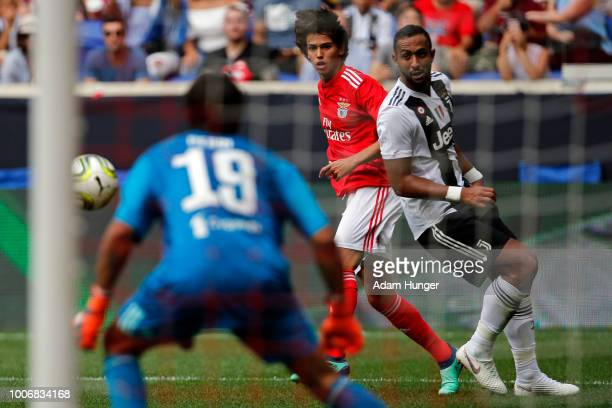 Joao Felix of Benfica watches his shot against Matlia Perin of Juventus during the International Champions Cup 2018 match between Benfica and...