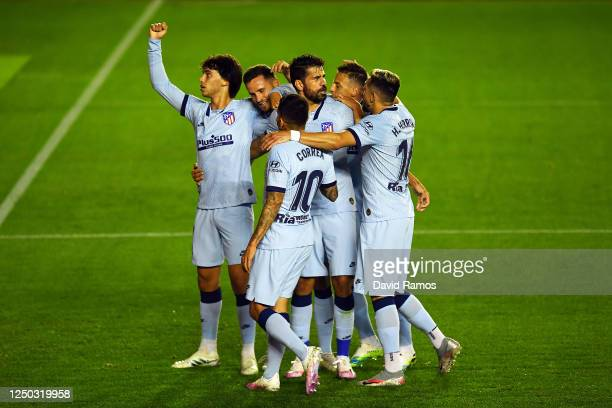Joao Felix of Club Atletico de Madrid celebrates with his team after scoring the opening goal during the Liga match between CA Osasuna and Club...