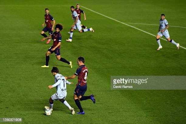 Joao Felix of Club Atletico de Madrid holds off Unai Garcia of Osasuna during the Liga match between CA Osasuna and Club Atletico de Madrid at on...