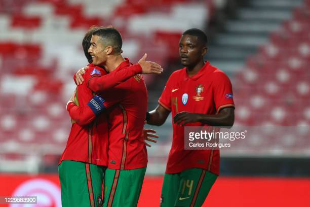 Joao Felix of Portugal and Atletico Madrid celebrates scoring Portugal seven goal with Cristiano Ronaldo of Portugal and Juventus during the...