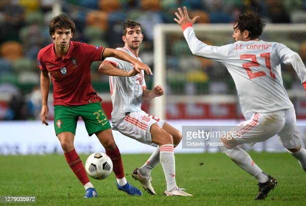 Joao Felix of Portugal is tackled by Sergi Roberto of Spain during the international friendly match between Portugal and Spain at Estadio Jose...