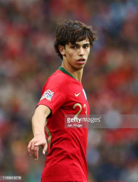 Joao Felix of Portugal points during the UEFA Nations League SemiFinal match between Portugal and Switzerland at Estadio do Dragao on June 05 2019 in...
