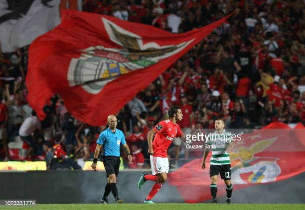 Joao Felix of SL Benfica celebrates after scoring a goal during the Liga NOS match between SL Benfica and Sporting CP at Estadio da Luz on August 25...