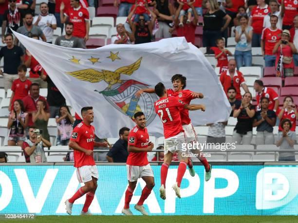 Joao Felix of SL Benfica celebrates with teammates after scoring a goal during the Liga NOS match between SL Benfica and CD Aves at Estadio da Luz on...