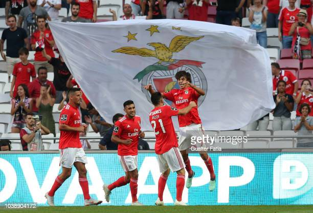Joao Felix of SL Benfica celebrates with teammates after scoring a goal during the Liga NOS match between SL Benfica and CD Aves at Estadio da Luz on...