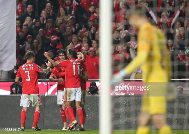 Joao Felix of SL Benfica celebrates with teammates after scoring a goal during the Liga NOS match between SL Benfica and Rio Ave FC at Estadio da Luz...