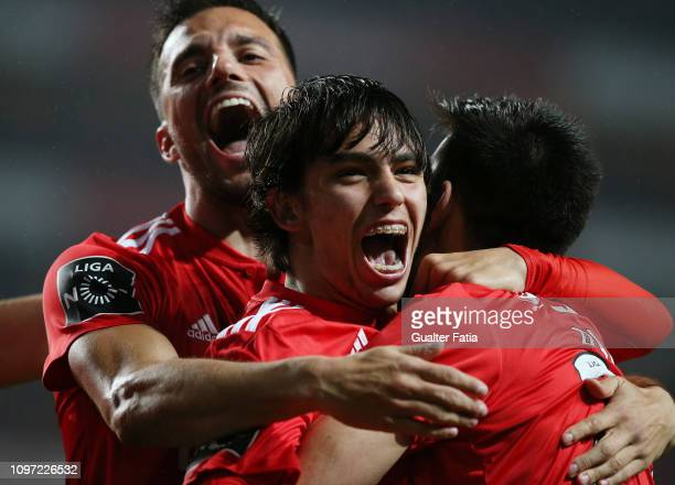Joao Felix of SL Benfica celebrates with teammates after scoring a goal during the Liga NOS match between SL Benfica and CD Nacional at Estadio da...