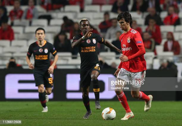 Joao Felix of SL Benfica with Henry Onyekuru of Galatasaray in action during the UEFA Europa League Round of 32 Second Leg match between SL Benfica...