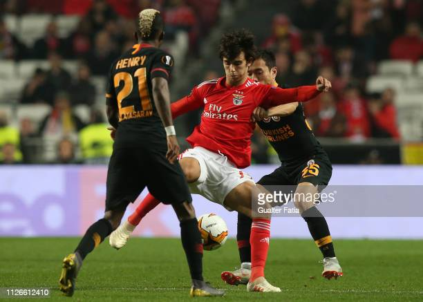 Joao Felix of SL Benfica with Yuto Nagatomo of Galatasaray in action during the UEFA Europa League Round of 32 Second Leg match between SL Benfica...