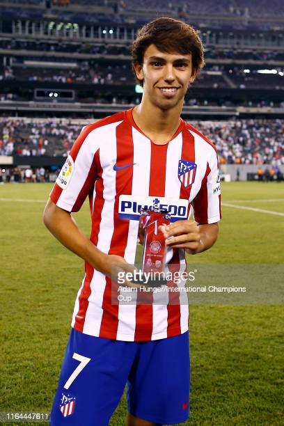 Joao Felix Sequeira of Atletico Madrid is presented with man of the match following the International Champions Cup match against Real Madrid at...