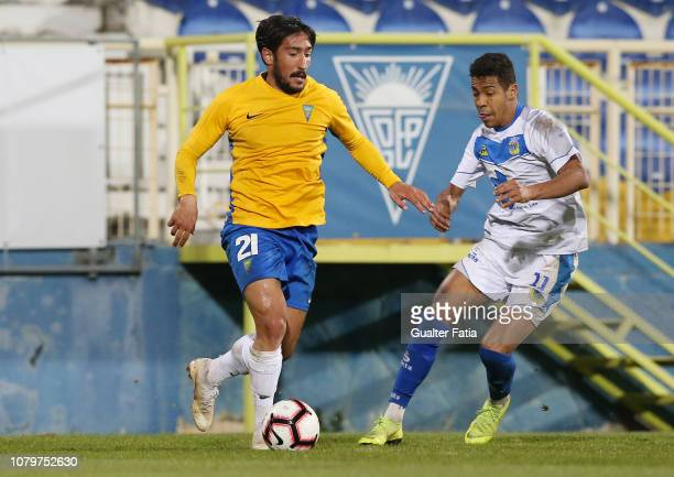 Joao Gois of GD Estoril Praia with Adilio Santos of FC Arouca in action during the Ledman Liga Pro match between GD Estoril Praia and FC Arouca at...