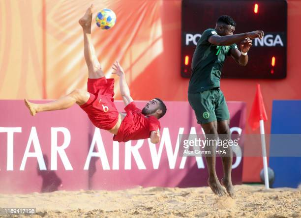 Joao Goncalves of Portugal is challenged by Godwin Iorbee of Nigeria during the FIFA Beach Soccer World Cup Paraguay 2019 group D match between...
