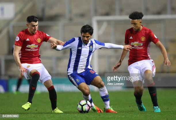 Joao Graca of Porto holds off a challenge from Regan Poole and Cameron BorthwickJackson of Manchester United during the Premier League International...