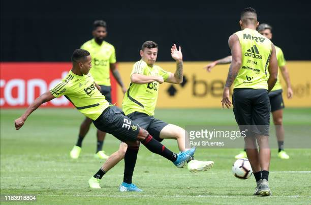 Joao Lucas and Hugo Moura of Flamengo fight for the ball during a training session at VIDENA on the day before the Copa Libertadores 2019 Final on...