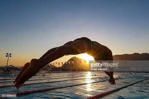 Joao Luiz Gomes Junior of Brazil jumps into the pool during the warm up at the Aquece Rio Test Event for the Rio 2016 Olympics at the Olympic...