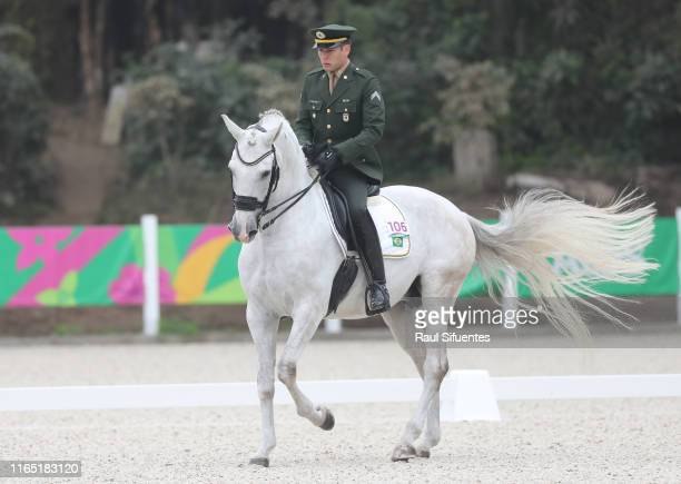Joao Marcari of Brazil riding Biso Das Lezirias competes during Equestrian Dressage Individual - Intermediate I / Grand Prix Special at Army...