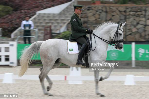 Joao Marcari of Brazil riding Bso Das Lezirias competes during Equestrian Dressage Individual - Intermediate I / Grand Prix Special at Army...