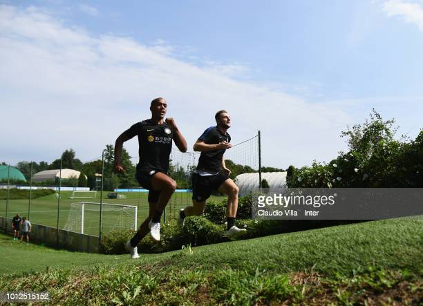 Joao Mario and Milan Skriniar of FC Internazionale in action during the FC Internazionale training session at the club's training ground Suning...