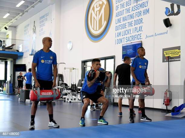 Joao Mario Joao Cancelo and Dalbert Henrique Chagas Estevão of FC Internazionale in action during a training session at Suning Training Center at...