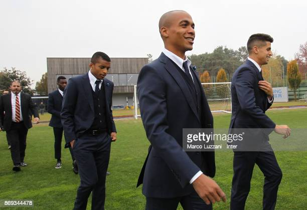 Joao Mario Joao Cancelo and Henrique Dalbert of FC Internazionale back stage during the FC Internazionale Official Photoshoot at the club's training...