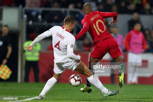 Joao Mario midfielder of Portugal vies with Thiago Cionek defender of Poland during the UEFA Nations League football match between Portugal and...