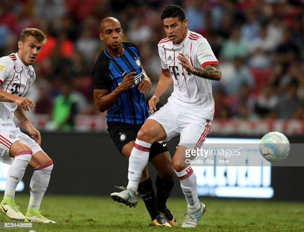 Joao Mario of FC Internazionale and James Rodriguez of Bayern compete for the ball during the International Champions Cup match between FC Bayern and...