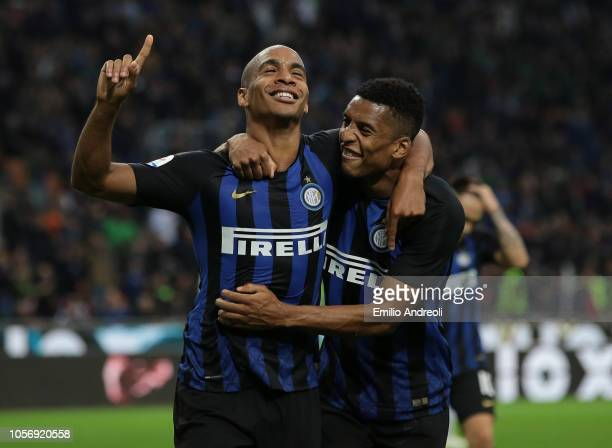 Joao Mario of FC Internazionale celebrates after scoring the third goal with his teammate Henrique Dalbert during the Serie A match between FC...
