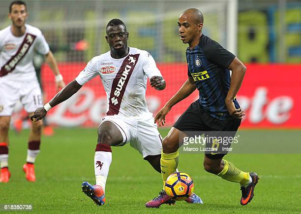 Joao Mario of FC Internazionale competes for the ball with Afriyie Acquah of FC Torinol during the Serie A match between FC Internazionale and FC...