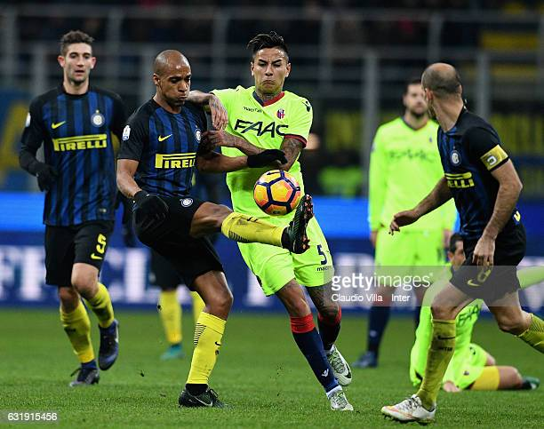 Joao Mario of FC Internazionale competes for the ball with Erick Pulgar of Bologna FC during the TIM Cup match between FC Internazionale and Bologna...
