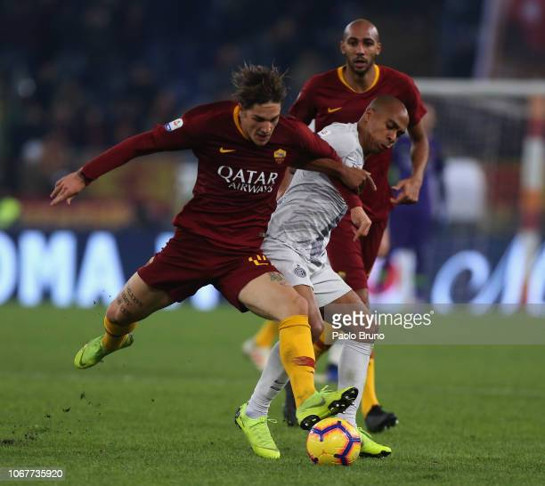 Joao Mario of FC Internazionale competes for the ball with Nicolo' Zaniolo of AS Roma during the Serie A match between AS Roma and FC Internazionale...