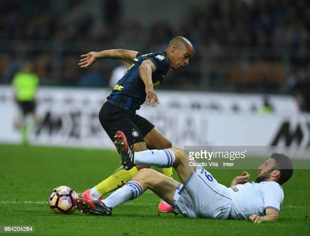 Joao Mario of FC Internazionale competes for the ball with Vasco Regini of UC Sampdoria during the Serie A match between FC Internazionale and UC...