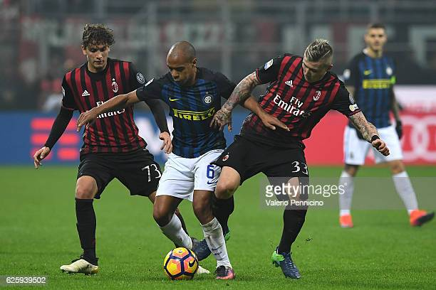 Joao Mario of FC Internazionale is challenged by Juraj Kucka and Manuel Locatelli of AC Milan during the Serie A match between AC Milan and FC...